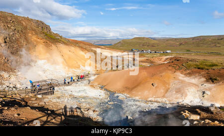 KRYSUVIK, ICELAND - SEPTEMBER 10, 2017: tourists at viewpoint in geothermal Krysuvik area on Southern Peninsula - Stock Photo