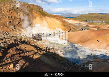 KRYSUVIK, ICELAND - SEPTEMBER 10, 2017: tourists at observation deck in geothermal Krysuvik area on Southern Peninsula - Stock Photo