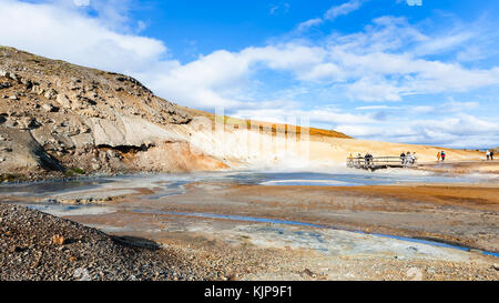 KRYSUVIK, ICELAND - SEPTEMBER 10, 2017: tourists at viewpoint near mud pot crater in geothermal Krysuvik area on - Stock Photo