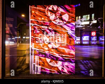Munich, Bavaria, Germany. 26th Nov, 2017. North Korean flag collage in a vacant store window in wealthy Munich, - Stock Photo