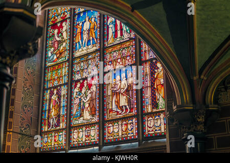 Stained-glass in the impressive Basilica of the Holy Blood, Bruges, Belgium. - Stock Photo
