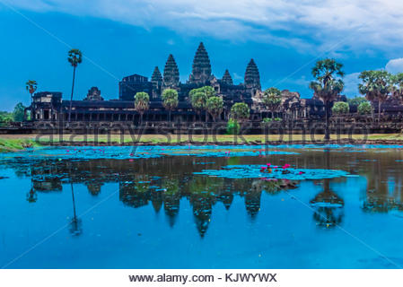 View of Angkor Wat with pond. It is the largest religious monument in the world. It's name means City which is a - Stock Photo