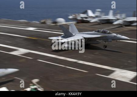 An F/A-18F Super Hornet assigned to the Jolly Rogers of Strike Fighter Squadron VFA 103 lands on the flight deck - Stock Photo