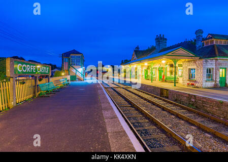 CORFE, UNITED KINGDOM - SEPTEMBER 08: This is an evening view of the Corfe Castle railway station traditional medieval - Stock Photo