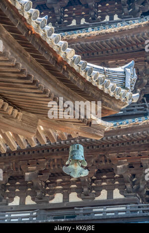 Wooden roof detail of Tokondo and Five-story pagoda (Go-Ju-No-To) in the background at Kofuku-ji temple. Located - Stock Photo