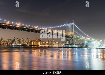 Robert F. Kennedy Bridge (aka Triboro Bridge) at night, in Astoria, Queens, New York - Stock Photo