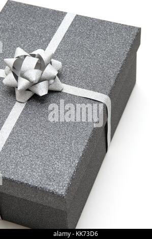 Black gift box with silver ribbon on white background - Stock Photo