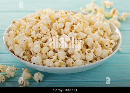 Cheddar cheese popcorn in a white bowl - Stock Photo