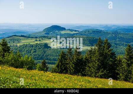 View from the Wasserkuppe to the mountain Milseburg, nature park Park Hessische Rhön, Hesse, Germany - Stock Photo