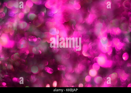 purple sparkling lights festive background. Abstract twinkled bright bokeh. Defocused winter card or invitation. - Stock Photo