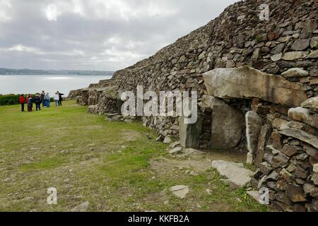 Early Neolithic 6800 year old Cairn Tumulus Mound of Barnenez contains 11 passage grave chambers. Plouezoc'h, Finistere, - Stock Photo