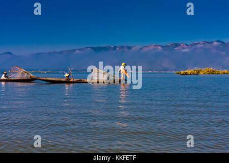 Iconic fishermen on the Inle Lake, Taunggyi, Myanmar - Stock Photo