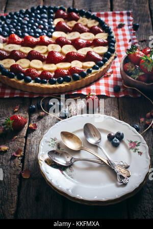 Empty plates  and American flag pie in background.4th of July concept - Stock Photo
