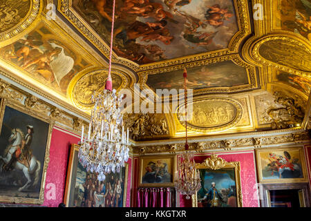 Ornate ceiling in the Red bedroom chamber at Chateau de Versailles near Paris France - Stock Photo