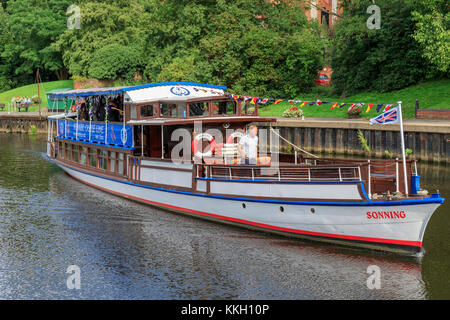 Newark on Trent river pleasure cruiser The Sonning underway and entering the town locks with a wedding party on - Stock Photo