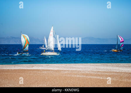 Rhodes, Greece - August 26, 2017: Ship yachts with white sails in the sea. - Stock Photo