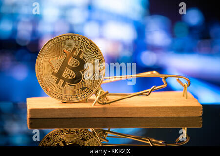 Bitcoin in mouse trat, financial trap concept. - Stock Photo