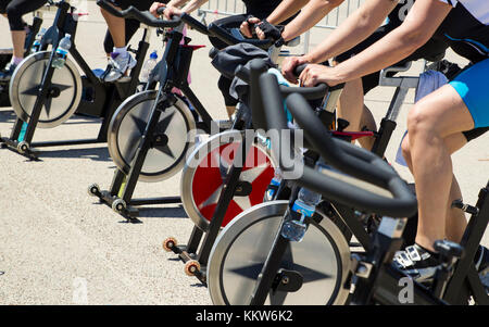 Legs moving during a workout of spinning-----Imperia, IM, Italy - May 18, 2014: People perform a spinning session - Stock Photo
