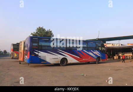 Long distance bus parked at service area in Udaipur India. - Stock Photo