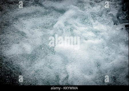 Fresh and bubbling water of a mountain torrent - Stock Photo