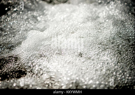 Close up of a torrent with bubbling water - Stock Photo