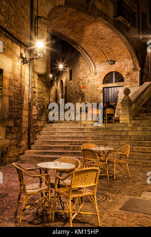 City of Girona at night, Pujada de Sant Domenec stairs and Arch of the Agullana Palace in Old Town, Catalonia, Spain - Stock Photo