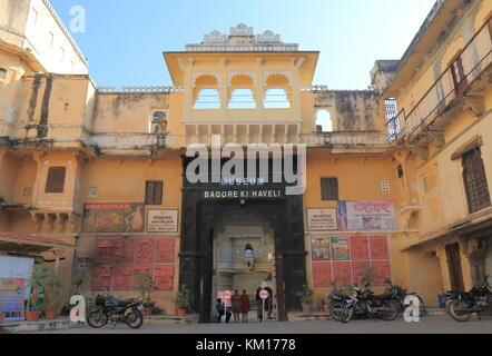 People visit Museum Bagore Ki Haveli in Udaipur India. Museum Bagore Ki Haveli is one of the most popular tourist - Stock Photo