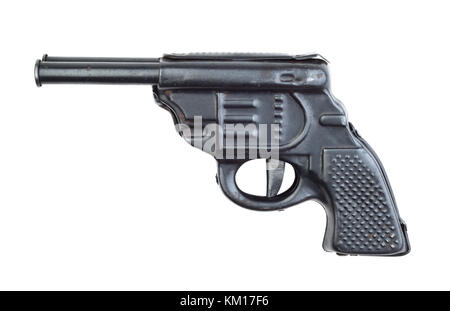 Toy metal old gun isolated on white background - Stock Photo
