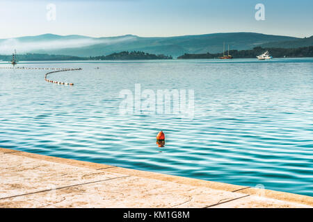 View of Kotor Bay in the Adriatic Sea in the background of the Balkan Mountains. Quay of the city of Tivat in the - Stock Photo