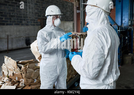 Workers in Recycling Plant Warehouse - Stock Photo