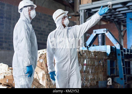 Workers in Hazmat Suits at Modern Factory - Stock Photo