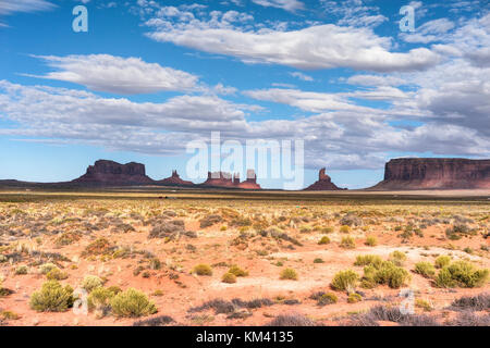 Monument Valley red sand region on the Arizona-Utah border, USA. Navajo Tribal Park and used for a location for - Stock Photo