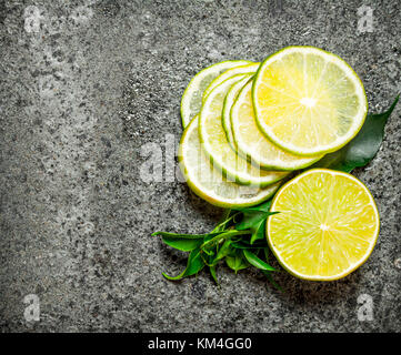 Slices of citrus fruits. Top view. On rustic background - Stock Photo