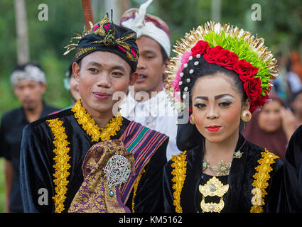 Indonesian bride and groom at traditional wedding on the island Lombok, Indonesia - Stock Photo