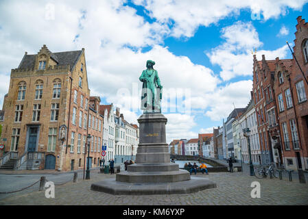 Bruges, Belgium - April 17, 2017: Statue of the Flemish painter Jan van Eyck in Bruges, Belgium - Stock Photo