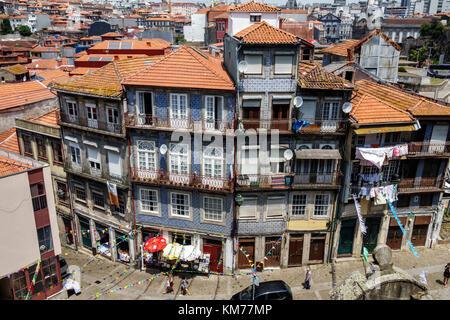 Porto Portugal Baixa residential apartment building city skyline rooftops ceramic tiles historic center buildings - Stock Photo