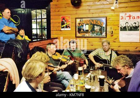 Traditional Irish pub music session in Days Bar on the west coast island of Inishbofin, County Galway, Ireland. - Stock Photo