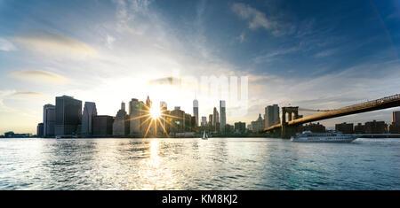 New York City - beautiful sunset over manhattan with manhattan and brooklyn bridge USA - Stock Photo