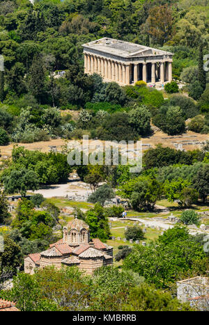 The Byzantine Church of the Holy Apostles and the Temple of Hephaestus in Athens, Greece - Stock Photo