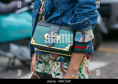 MILAN - SEPTEMBER 23: Woman with green Prada bag and blue jeans jacket before Antonio Marras fashion show, Milan - Stock Photo