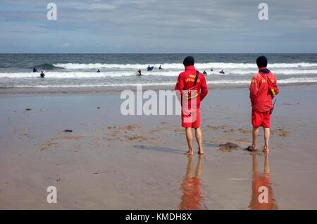 RNLI lifeguards at Coldingham Bay - Stock Photo
