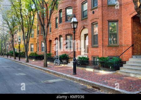 Townhouse in Back Bay, Boston. Brick apartment buildings and tree-lined street in the fall. Elegant streetscape. - Stock Photo