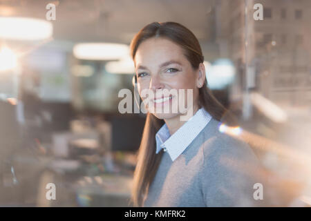 Portrait smiling, confident businesswoman wearing headset in office - Stock Photo