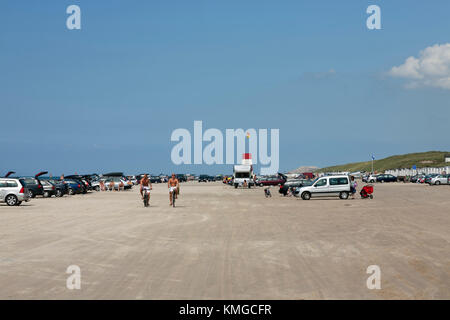 The famous beach at Blokhus in north-western Jutland, Denmark, where cars are allowed on the beach. - Stock Photo