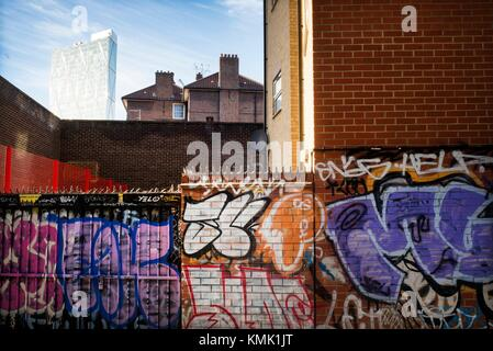 Graffiti on wall. Grey Eagle St. East End, London, England - Stock Photo