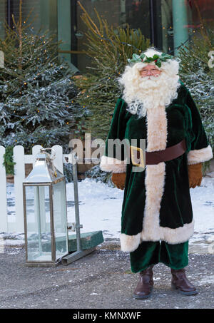 Santa Claus dressed in green Victorian Father Christmas costume at Victorian Festival of Christmas at Portsmouth, - Stock Photo