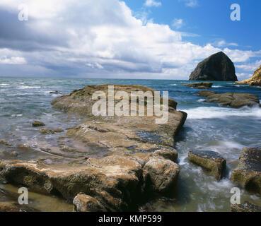 Cape Kiwanda and Haystack Rock. Cape Kiwanda State Park. Pacific City. Oregon Coast. Tillamook County. Oregon. USA. - Stock Photo