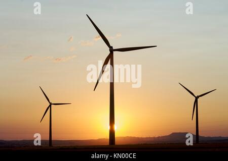 backlight windmills and the sun in Gurrea de Gallego, Huesca, Aragon, Spain - Stock Photo