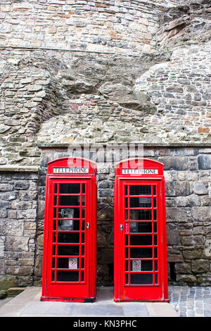 Traditional British landmark: two red telephone boxes in Edimburgh. - Stock Photo