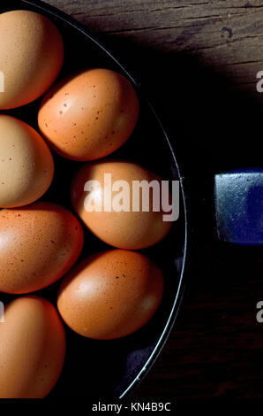 Whole brown egg in cast pan fried. - Stock Photo